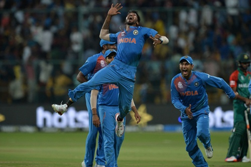 Indian bowler Hardik Pandya(C) jumps to celebrate the wicket that led to the victory of India in the last ball by 2 runs during the World T20 cricket tournament match between India and Bangladesh at The Chinnaswamy Stadium in Bangalore on March 23, 2016.  / AFP / MANJUNATH KIRAN        (Photo credit should read MANJUNATH KIRAN/AFP/Getty Images)
